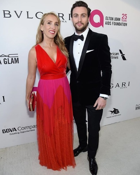 Aaron Taylor Johnson with wife Sam Taylor Johnson in Givenchy